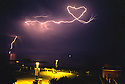 A lightning bolt flashes in the shape of a heart off the coast on Oceanside, California. Prints of this image are for sale. freelance photo by Bill Wechter