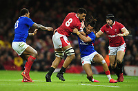 Taulupe Faletau of Wales is tackled by Teddy Thomas of France during the Guinness Six Nations Championship Round 3 match between Wales and France at the Principality Stadium in Cardiff, Wales, UK. Saturday 22 February 2020