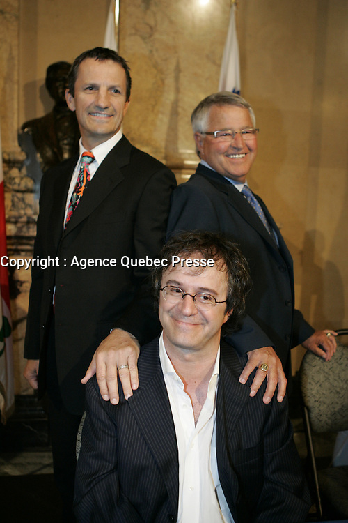 Montreal (Qc) CANADA - August 2009 24 file Photo : Gerald Tremblay, Julie Snyder, Stephane Laporte announce an upcoming TV show about the Hockey rivalty between Montreal and Quebec cities