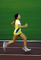 Female runner during 1 2 marathon race, final lap, blurred, motion, speed, competition, endurance, woman, women, racing, races; NR.
