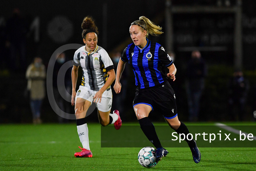 Brugge's Celien Guns pictured in front of defending midfielder Ines Dhaou of Sporting Charleroi during a female soccer game between Sporting Charleroi and Club Brugge YLA on the fourth matchday of the 2020 - 2021 season of Belgian Scooore Womens Super League , friday 9 nd of October 2020  in Marcinelle , Belgium . PHOTO SPORTPIX.BE | SPP | DAVID CATRY