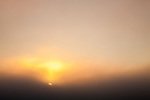 The sun rises through a thick layer of summer fog in  Cape Cod National Seashore, Truro, Massachusetts, USA