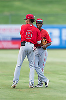 AZL Angels shortstop Jeremiah Jackson (8) and second baseman Daniel Ozoria (23) wish each other good luck before an Arizona League game against the AZL Diamondbacks at Tempe Diablo Stadium on July 16, 2018 in Tempe, Arizona. The AZL Diamondbacks defeated the AZL Angels by a score of 4-3. (Zachary Lucy/Four Seam Images)