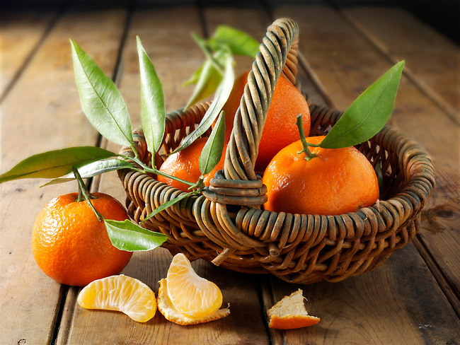 Fresh mandarins fruits with leaves.