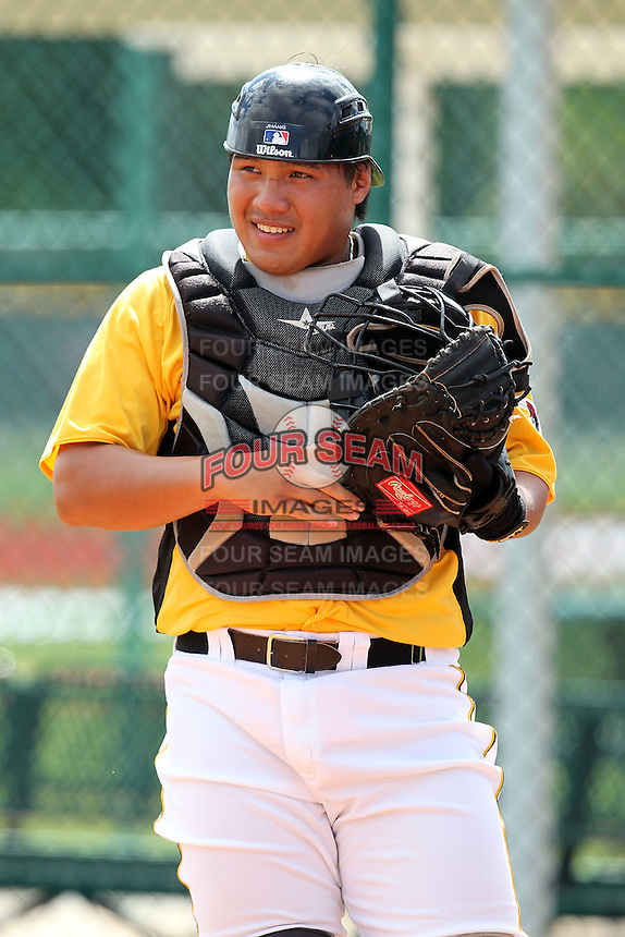 Pittsburgh Pirates catcher Jin-De Jhang #27 during practice before an Instructional League game against the Philadelphia Phillies at Pirate City on October 11, 2011 in Bradenton, Florida.  (Mike Janes/Four Seam Images)