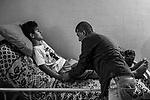Beach Camp, Gaza: Nour's father is taking care of him while changing Nour's position every now and then. With his wife, they wash him, change his clothes, feed him and change his urine bags and diapers.Doctors in Gaza being unable to do anything for him, Nour's parents tried to bring him to a hospital in Cairo (Egypt) but his admission was refused due to lack of financial means. His parents hope to one day be able to bring him a Europe, October 29, 2019. <br /> <br /> Beach Camp, Gaza: le père de Nour prend soin de lui en changeant sa position de temps en temps. Avec sa femme, ils le lavent, changent de vêtements, le nourrissent et changent ses poches à urine et couches. Les docteurs à Gaza ne pouvant rien faire pour lui, les parents de Nour ont essayé de l'amener dans un hôpital au Caire (Egypte) mais son admission a été refusée, faute de moyen financier. Ses parents espèrent pouvoir un jour l'amener un Europe, le 29 octobre 2019.