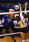 Marymount's Morgan McAlpin hits against St. Mary's during a college volleyball game in Lexington Park, MD, on Wednesday, Oct. 29, 2014. Marymount won 3-2 to go 24-9 on the season.<br /> Photo by Cathleen Allison