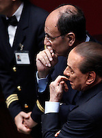 Il leader del Popolo della Liberta' Silvio Berlusconi attende di votare dopo essere arrivato in ritardo alla seduta comune di senatori e deputati per l'elezione del nuovo Capo dello Stato alla Camera dei Deputati, Roma, 18 aprile 2013..Italian People of Freedom party's leader Silvio Berlusconi waits to vote during the common plenary session of senators and deputies to elect the new Head of State, at the Lower Chamber in Rome, 18 April 2013..UPDATE IMAGES PRESS/Riccardo De Luca.
