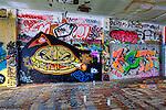 Graffiti adorns walls of a parking garage opened to urban art.  Tacoma, Washington.