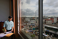 Pablo Fajardo looks out from a room in the Superior Court of Justice building at the town of Nueva Loja. He is the lead attorney for plaintiffs in a class action lawsuit brought against US multinational Texaco (acquired by Chevron in 2001) by more than 30,000 Ecuadorians. The case has been in the Ecuadorian courts since 2003 and relates to the dumping of billions of gallons of toxic materials into unlined pits and Amazonian rivers. In February 2011 the court ruled that Chevron should pay a fine totalling 9.5 billion USD. However, Chevron has stated that the ruling is 'illegitimate and unenforceable' and has started numerous counter proceedings in US courts. There is some doubt as to whether it will be possible to force Texaco to pay the fine.