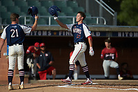 DeAngelo Giles (23) (NC State) of the High Point-Thomasville HiToms celebrates with teammate Hogan Windish (21) (UNCG) after hitting a home run against the Deep River Muddogs at Finch Field on June 27, 2020 in Thomasville, NC.  The HiToms defeated the Muddogs 11-2. (Brian Westerholt/Four Seam Images)