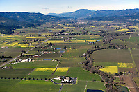 aerial photograph of Napa Valley from Oakville to Calistoga.  Opus One is in the foreground., the Napa river to the right