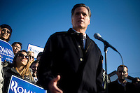 """Republican presidential candidate Mitt Romney, former governor of Massachusetts, speaks to the media during a """"press availability"""" after a rally in Manchester, New Hampshire, on Sat. Dec. 3, 2011. The rally was called, """"Earn It with Mitt,"""" and was designed to bolster local efforts to help Romney """"earn"""" voters' support for the upcoming Republican primary."""