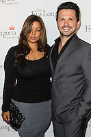 HOLLYWOOD, LOS ANGELES, CA, USA - OCTOBER 09: Elsie Rodriguez, Freddy Rodriguez arrive at the Eva Longoria Foundation Dinner held at Beso Restaurant on October 9, 2014 in Hollywood, Los Angeles, California, United States. (Photo by Celebrity Monitor)