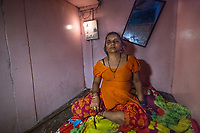 India, Maharashtra, Mumbai, Bombay, red light district.<br /> This is Rupa's room, nothing more than bed. She works as a sex worker, was heavily abused and now works as a pimp, running cigarettes and alcohol.