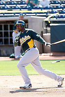 Chris Carter #22 of the Oakland Athletics bats in an intrasquad game during spring training workouts at Phoenix Municipal Stadium on February 24, 2011  in Phoenix, Arizona. .Photo by:  Bill Mitchell/Four Seam Images.