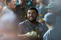 Davion Downey (9) of the Baylor Bears is congratulated by his teammates in the dugout after hitting a home run against the Arkansas Razorbacks in game nine of the 2020 Shriners Hospitals for Children College Classic at Minute Maid Park on March 1, 2020 in Houston, Texas. The Bears defeated the Razorbacks 3-2. (Brian Westerholt/Four Seam Images)