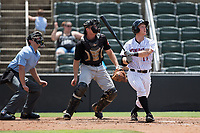 Casey Schroeder (17) of the Kannapolis Intimidators follows through on his swing against the West Virginia Power at Kannapolis Intimidators Stadium on June 18, 2017 in Kannapolis, North Carolina.  The Intimidators defeated the Power 5-3 to win the South Atlantic League Northern Division first half title.  It is the first trip to the playoffs for the Intimidators since 2009.  (Brian Westerholt/Four Seam Images)
