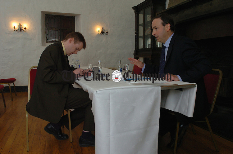 Health Minister Michéal Martin TD speaking with 'Champion reporter dan Danaher before meeting with local Fianna Fail members at the old Ground Hotel. Photogrph by John Kelly.