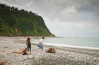 Two women on a beach in Okarito - Westland National Park, West Coast, New Zealand