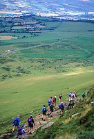 Wales, Offa's Dyke Footpath.  Hikers Descending Hays Bluff, heading to Hay-on-Wye.