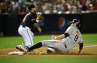 May 12, 2012; Phoenix, AZ, USA; San Francisco Giants first baseman Brandon Belt slides safely into third with a triple ahead of the throw to Arizona Diamondbacks third baseman Ryan Roberts in the ninth inning at Chase Field. Mandatory Credit: Mark J. Rebilas-