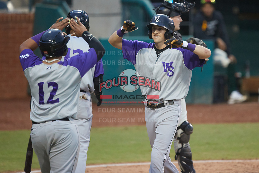 Duke Ellis (11) of the Winston-Salem Dash is greeted by teammate Xavier Fernandez (12) at home plater after hitting a home run against the Greensboro Grasshoppers at First National Bank Field on June 3, 2021 in Greensboro, North Carolina. (Brian Westerholt/Four Seam Images)
