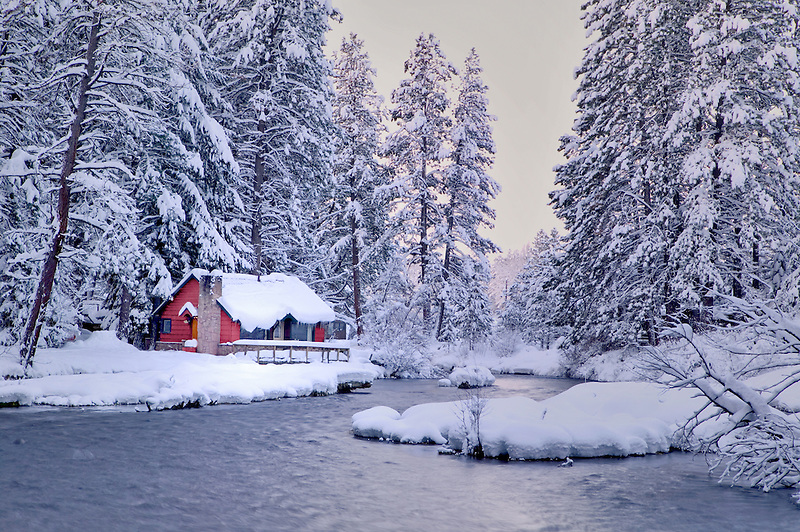 Metolius River in snow with cabin. Oregon