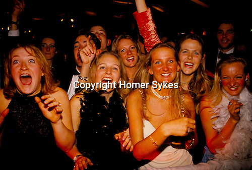 Cirencester Agricultural College. End of year ball 1995. Students immediately in front of the stage where a group have just been performing.