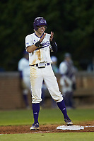 Will Prater (5) of the Western Carolina Catamounts claps for his teammate Trevor Jones (not pictured) during the game against the St. John's Red Storm at Childress Field on March 13, 2021 in Cullowhee, North Carolina. (Brian Westerholt/Four Seam Images)