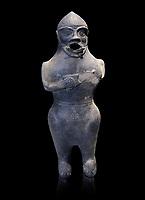 Anthropomorphic Hittite jug in terra cotta from the Hittite Period. Adana Archaeology Museum, Turkey. Against a black background