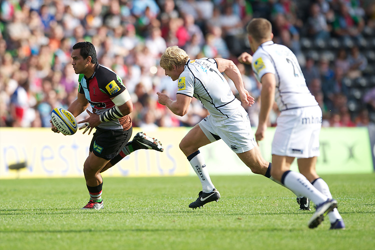 Maurie Fa'asavalu of Harlequins is chased down by David Seymour (centre) and Will Cliff of Sale Sharks during the Aviva Premiership match between Harlequins and Sale Sharks at The Twickenham Stoop on Saturday 15th September 2012 (Photo by Rob Munro)