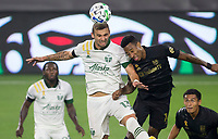 LOS ANGELES, CA - SEPTEMBER 13: Dario Zuparic #13 of the Portland Timbers battles with Mark-Anthony Kaye #14 for a head ball during a game between Portland Timbers and Los Angeles FC at Banc of California stadium on September 13, 2020 in Los Angeles, California.