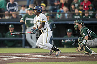 Michigan Wolverines second baseman Ako Thomas (4) follows through on his swing against the Michigan State Spartans during the NCAA baseball game on April 18, 2017 at Ray Fisher Stadium in Ann Arbor, Michigan. Michigan defeated Michigan State 12-4. (Andrew Woolley/Four Seam Images)