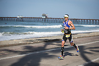 Andy Potts runs down the strand in the Accenture Ironman California 70.3 in Oceanside, CA on March 29, 2014.