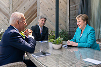 President Joe Biden meets for a brief pull-aside meeting with German Chancellor Angela Markel during the G7 Summit at the Carbis Bay Hotel and Estate on Saturday, June 12, 2021, in St. Ives, Cornwall, England. (Official White House Photo by Adam Schultz)