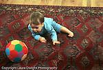 11 month old boy full length commando crawling toward ball