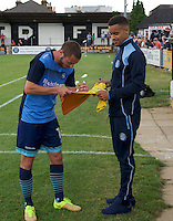 Sam Wood of Wycombe Wanderers signs a shirt for a fan before the Friendly match between Maidenhead United and Wycombe Wanderers at York Road, Maidenhead, England on 30 July 2016. Photo by Alan  Stanford PRiME Media Images.