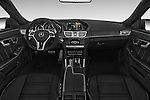 Stock photo of straight dashboard view of a 2015 Mercedes Benz E Class E63 AMG S 5 Door Wagon Dashboard