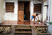A man washes the front of his old house in the UNESCO heritage city of Georgetown in Penang, Malaysia. Photo: Sanjit Das/Panos