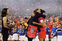 CHARLOTTE, NC - OCTOBER 3: Ali Krieger #11 of the United States is honored by Cindy Parlow Cone and Kate Markgraf for playing 100 games for the national team during a game between Korea Republic and USWNT at Bank of America Stadium on October 3, 2019 in Charlotte, North Carolina.