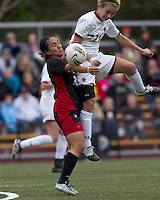 Boston College forward/midfielder Kate McCarthy (21) heads a corner kick into NC State forward Tanya Cain (25). Boston College defeated North Carolina State,1-0, on Newton Campus Field, on October 23, 2011.