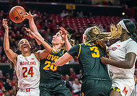 COLLEGE PARK, MD - FEBRUARY 13: Stephanie Jones #24 of Maryland and Kate Martin #20 of Iowa reach up for a loose ball during a game between Iowa and Maryland at Xfinity Center on February 13, 2020 in College Park, Maryland.