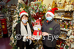 Mary Burke from Ballyduff been shown the Christmas decorations by Mairead Roberts in the Listowel Garden Centre