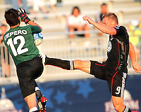 Danny Allsopp #9 of D.C. United kicks the ball away from Danny Cepero #12 of the Harrisburg City Islanders during a US Open Cup match at the Maryland Soccerplex on July 21 2010, in Boyds, Maryland. United won 2-0.