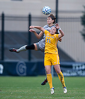 Kailey Blain (25) of Georgetown goes up for a header with Anna Dolhansky (11) of La Salle during the first round of the NCAA tournament at Shaw Field in Washington, DC.  Georgetown defeated La Salle, 2-0.