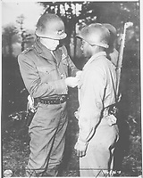 Patton,U.S.Third_Army commander, pins the Silver Star on Private Ernest A. Jenkins of New-York,  October 13, 1944