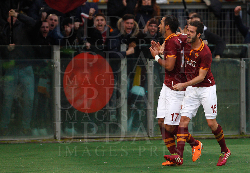 Calcio, Serie A: Roma vs Catania. Roma, stadio Olimpico, 22 dicembre 2013.<br /> AS Roma defender Mehdi Benatia, of Morocco, celebrates with teammate Miralem Pjanic, of Bosnia, right, after scoring his second goal during the Italian Serie A football match between AS Roma and Catania, at Rome's Olympic stadium, 22 December 2013.<br /> UPDATE IMAGES PRESS/Riccardo De Luca