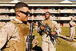 October 22, 2014. Camp LeJeune, North Carolina.<br />  LCpl. Wykeam Miller, age 20, pauses during patrol training for the 3rd Platoon of the Ground Combat Element Integrated Task Force. Marines in 3rd Platoon of the GCEITF are all considered provisional infantrymen as they have not been to the School of Infantry (SOI) previous to volunteering for the GCEITF.<br />  The Ground Combat Element Integrated Task Force is a battalion level unit created in an effort to assess Marines in a series of physical and medical tests to establish baseline standards as the Corps analyze the best way to possibly integrate female Marines into combat arms occupational specialities, such as infantry personnel, for which they were previously not eligible. The unit will be comprised of approx. 650 Marines in total, with about 400 of those being volunteers, both male and female. <br />  Jeremy M. Lange for the Wall Street Journal<br /> COED