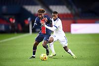 24th December 2020; Paris, France; French League 1 football, Paris St Germain versus Strasbourg;  TIMOTHEE PEMBELE PSG holds off LIONEL CAROLE STRA
